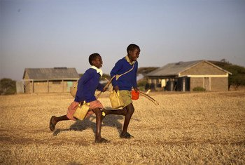 A scene of two young boys running from the film 'On the Way to School.'
