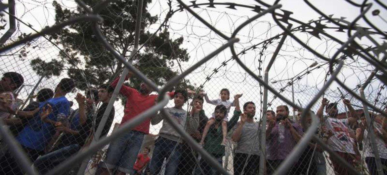 Asylum-seekers in a holding centre on Greece's Samos Island.