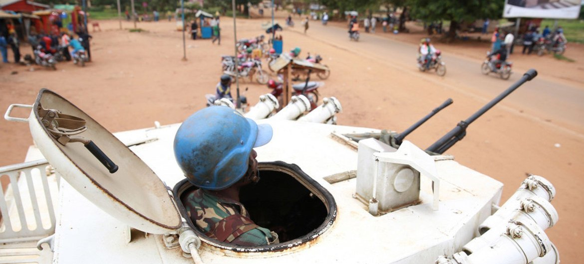 A peacekeeper in an armoured vehicle providing protection for civilians in downtown Beni, Democratic Republic of the Congo (DRC).
