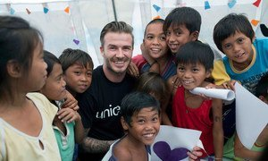 UNICEF Goodwill Ambassador David Beckham meets child survivors of Typhoon Haiyan in the Philippines.