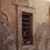A girl looks out of her house window in Benghazi, Libya.