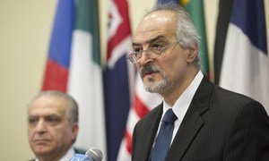 Ambassadors representing two countries under attack from ISIL, Bashar Ja'afari (right) of Syria, and Mohamed Ali Alhakim of Iraq, speak to journalists following the adoption of a Security Council resolution targeting sources of financing for the group.