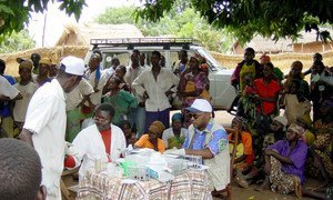 A mobile team of national health care workers performing systematic screening of population for human sleeping sickness in Bodo village, Chad.