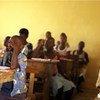 An Albino student (right) attends school in Niambly, near Duekoue, Côte d'Ivoire.
