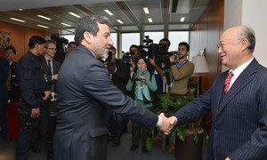 IAEA Director General Yukiya Amano (right) meets with the Deputy for Legal and International Affairs of the Ministry of Foreign Affairs of Iran, Seyyed Abbas Araghchi, at IAEA Headquarters in Vienna, Austria, on 24 February 2015.