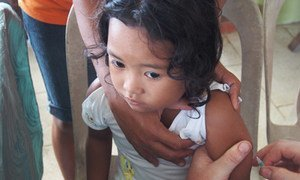 A girl being vaccinated against measles. Photo: UNICEF/Heather Papowitz