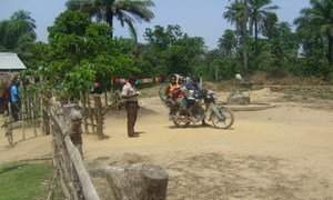 This motorbike has crossed the border from Sarkonedou in Liberia to Koutizou in Guinea. The opening of Liberia's official borders enables economic activities and allows students to attend school.