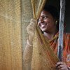 Une jeune femme issue d'une communauté de pêcheurs au Bengale occidental en Inde orientale. Elle vient d'un village connu pour ses niveaux élevés de traite des femmes et des filles en direction de grandes villes. Photo : ONU Femmes / Anindit Roy-Chowdhury