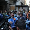 UNRWA Commissioner-General Pierre Krähenbühl (centre) speaks to the press during a visit to Yarmouk Syria.