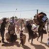 Sirios de Kurdistán cruzando hacia Turquía. Foto: ACNUR/I.Prickett