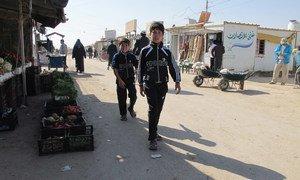 Syrian refugee children walking on a street in the Za'atari camp in northern Jordan.