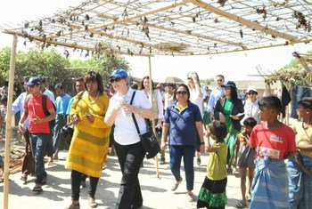 UNDP Administrator Helen Clark (wearing blue cap) and WFP Executive Director Ertharin Cousin (wearing yellow) visit the Thet Kae Pyin settlement for internally displaced people in Sittwe, Rakhine State, Myanmar.