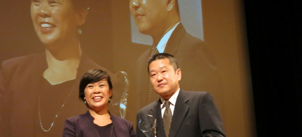 Producer Sen Zhang (right) collects award for film Rebuilding Sichuan at first International Awards for the Best TV Documentaries on Disaster Risk Reduction alongside ceremonys host, broadcaster Veronica Pedrosa (left), in Sendai, Japan.