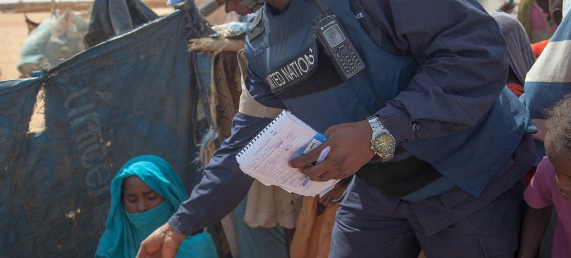 A UNAMID peacekeeper interacts with a woman during a daily patrol aimed at protecting newly-displaced persons at the Zam Zam camp near El Fasher, North Darfur.