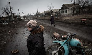 Residents walk along the main road of Nikishino village in eastern Ukraine.
