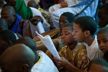 Children reading a panegyric during a festival in Timbuktu, Mali.