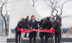 """Secretary-General Ban Ki-moon (centre left) and Sam Kutesa (centre right), President of the General Assembly, cut the ribbon at the unveiling ceremony of """"The Ark of Return,"""" the Permanent Memorial to honour the Victims of Slavery and the Transatlantic Slave Trade."""