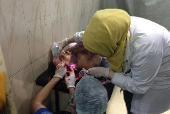 Doctors treat a seriously injured man for head wounds at the Al Razy surgical hospital, one of only 4 remaining hospitals in Aleppo, Syria.