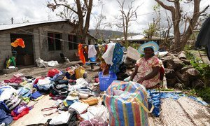 Helen Manvoi sorts through  damaged clothing after Cyclone Pam destroyed the roof of her house in Port vila, Vanuatu.