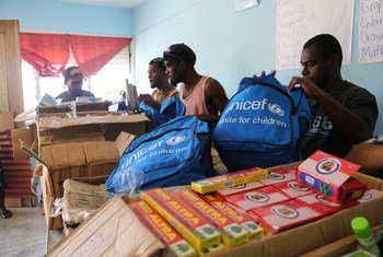 UNICEF staff and community volunteers in Port Vila, Vanuatu pack school kits with essential school supplies for children who lost everything in Cyclone Pam.
