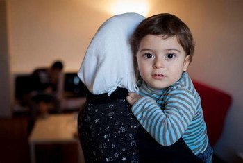 A mother and child crossed into Turkey after fleeing the Syrian town of Idleb.