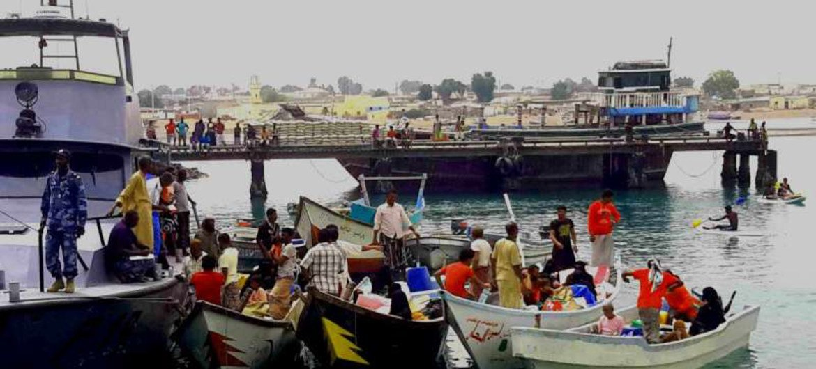 The Djibouti coastguard escorts boats carrying refugees from Yemen into the port of Obock.