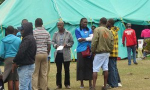UNHCR staff meet with displaced people at a site near Durban in KwaZulu-Natal province, South Africa.
