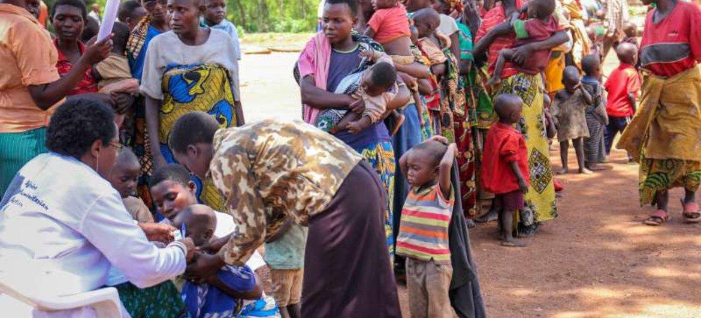 Mothers line up to register their children in Rwanda after fleeing their native Burundi.