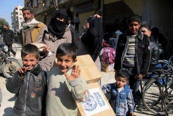 Muchas de las personas desplazadas del campamento de refugiados de Yarmouk se encuentran ahora repartidas por diferentes barrios de Siria.