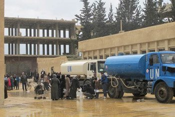 UNRWA distributes water in Babila, on the southern outskirts of Damascus, to the west of the Yarmouk Camp, Syria.