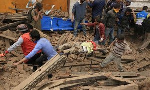 Rescuers at work in Kathmandu after Nepal's worst earthquake in 80 years.