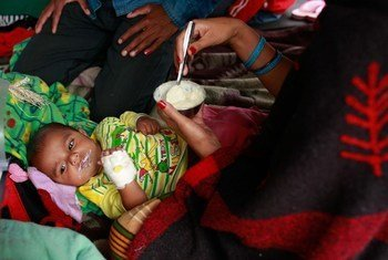 A woman feeds her infant, who was injured during the massive 25 April earthquake, at Tribhuvan University Teaching Hospital in Kathmandu, the capital of Nepal.