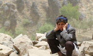 A boy sits amid rubble, all that remains of his home, which was destroyed in an air strike in Okash Village, near Sana'a, the capital of Yemen.
