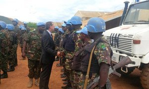 Martin Kobler, the Special Representative of the Secretary-General in the Democratic Republic of Congo (in suit) tells Tanzanian peacekeepers he strongly admires them despite the tragic loss of 2 comrades as they continue to actively protect the population.