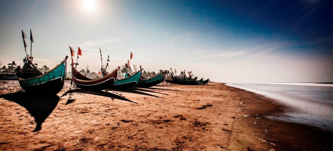 Fishing boats such as these, beached on a strip of coast in Teknaf, Bangladesh, are often used to ferry passengers to larger vessels in the Bay of Bengal bound for Thailand or Malaysia.