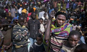 An elderly woman waits among a crowd of other Burundian refugees for assistance in Rwanda's Mahama Refugee Camp.