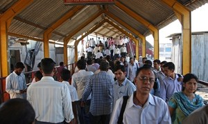 Passengers and commuters in a train station in Mumbai, India.