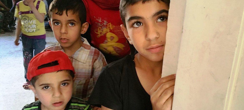 Children queue up at the UNRWA medical point in Yalda.