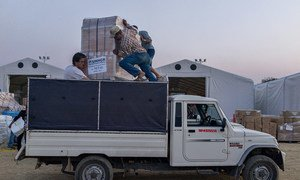 Volunteers load UNHCR relief supplies onto a truck at Tribhuvan International Airport in Kathmandu, Nepal. The aid will be distributed to affected areas across the country.