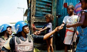 Members of a Formed Police Unit serving with the UN Stabilization Mission in Haiti (MINUSTAH) patrol a neighborhood in the capital, Port-au-Prince (2009).
