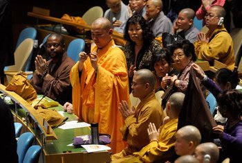A Buddhist monk takes snapshots during the UN's special event for the Day of Vesak, a celebration of the birth of Buddha, inside the General Assembly Hall in May 2011.