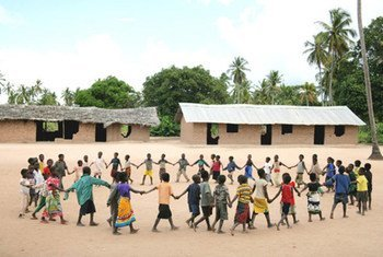 Children, holding hands to form a circle, play during recess at Mulemba Primary School in Zambezia Province, Mozambique.