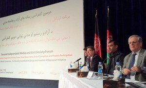 Deputy Special Representative for Afghanistan Mark Bowden (right) addresses the Second Independent Media and Civil Society Forum in Kabul.