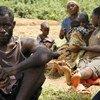 Gervais, de 51 años, con su mujer, cuatro hijos y dos sobrinos, huyeron de Burundi a Rwanda, cruzando el lago Cahoha. Foto: UNICEF/Y. Nijmbere