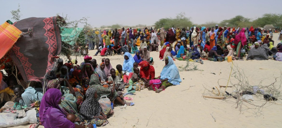 Thousands of people, mainly women and children, are scattered across the arid land of Nguigimi, Niger, after fleeing Boko Haram violence in Nigeria.