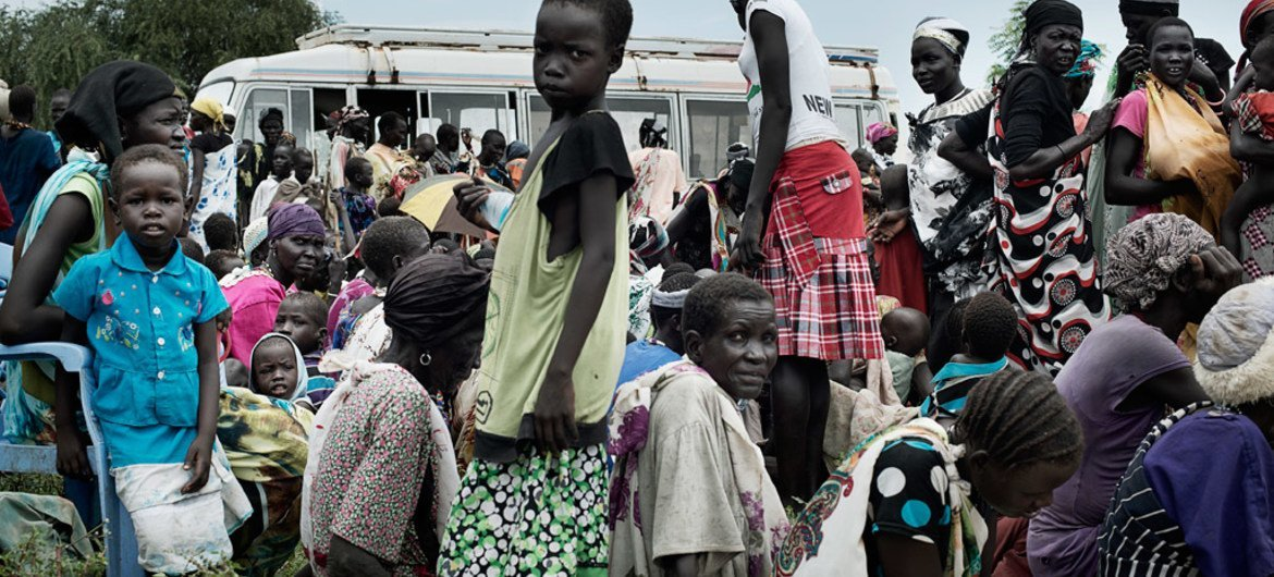 In Pathai, a settlement in Jonglei State, South Sudan, persons displaced by conflict await registration for food distribution.