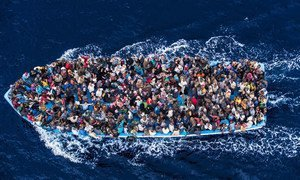 Hundreds of refugees and migrants aboard a fishing boat moments before being rescued by the Italian Navy as part of their Mare Nostrum operation in June 2014.