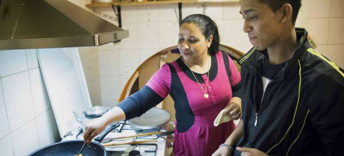 A Bangladeshi refugee family cook in their new restaurant in Budapest, Hungary where they have found security after a 20-year search for a safe home.