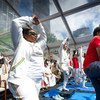 UN Secretary-General Ban Ki-moon practicing yoga at UN Headquarters, New York, for the very first International Yoga Day, on June 21, 2015.