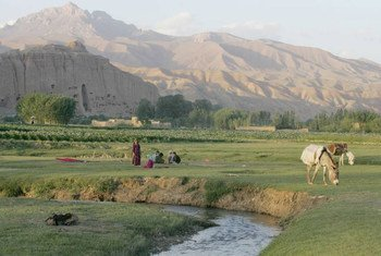 Mountains are critical for the valleys below. Farmers relax in Afghanistan's Bamyan Valley.
